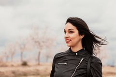 Pretty brunette girl with black leather jacket Royalty Free Stock Image