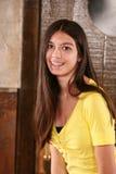 Pretty brunette girl with braces. Portrait of pretty hispanic teen girl in studio Royalty Free Stock Image