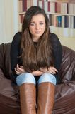 Pretty brunette girl in casual outfit and a Royalty Free Stock Images