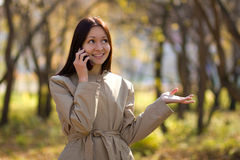 Pretty brunette girl on cellphone Royalty Free Stock Photos