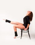 Pretty brunette girl on chair Stock Photo