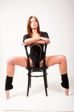 Pretty brunette girl on chair Royalty Free Stock Photos