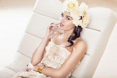 Pretty brunette woman with fabulous flower hat Stock Images