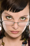 Pretty brunette girl in glasses portrait Stock Images