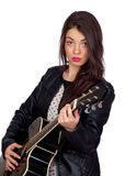 Pretty brunette girl with a guitar Royalty Free Stock Photo