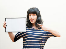 Pretty brunette girl indicating blank picture frame Stock Photography