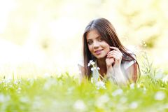 Pretty brunette girl laying on grass Royalty Free Stock Photo