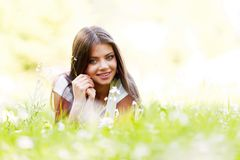 Pretty brunette girl laying on grass Stock Photography