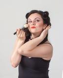 Pretty brunette girl posing like Marilyn Monroe Stock Photos