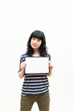 Pretty brunette girl showing blank picture frame Stock Photo