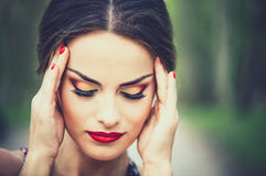 Pretty brunette girl touch her head becouse of headache Royalty Free Stock Photo