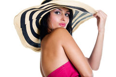 Pretty brunette girl wearing large hat Stock Photo