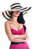 Pretty brunette girl wearing large hat Royalty Free Stock Photo