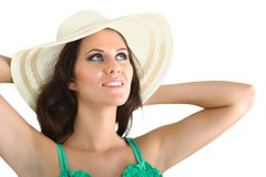 Pretty brunette girl wearing large hat isolated Stock Images