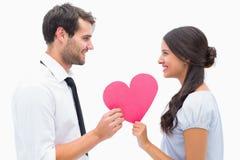 Pretty brunette giving boyfriend her heart Royalty Free Stock Photo