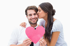 Pretty brunette giving boyfriend a kiss and her heart Royalty Free Stock Photos
