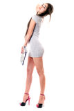 Pretty brunette in gray dress Royalty Free Stock Images