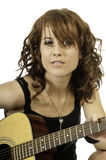 Pretty Brunette Guitar Player Royalty Free Stock Photography