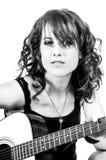 Pretty Brunette Guitar Player Stock Image