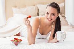 Pretty brunette having breakfast in bed Stock Photos