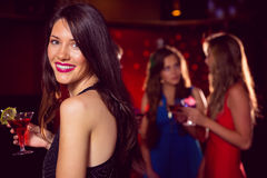 Pretty brunette having a cocktail Stock Image