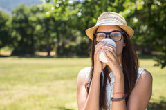 Pretty brunette having coffee to go Royalty Free Stock Photography