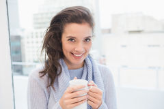 Pretty brunette having coffee by the window Royalty Free Stock Image