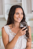 Pretty brunette having a glass of wine Stock Photography