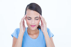 Pretty brunette with headache touching her temples Stock Image