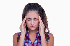 A pretty brunette with headache Stock Photography