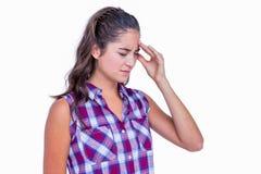 A pretty brunette with headache Stock Photo