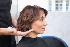 Pretty brunette at her hair appointment Stock Image