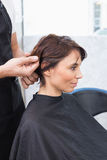 Pretty brunette at her hair appointment Stock Images