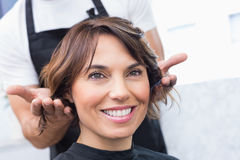 Pretty brunette at her hair appointment Royalty Free Stock Photography