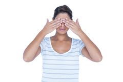 Pretty brunette hiding her eyes Royalty Free Stock Photography