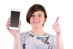Pretty brunette holding her smartphone and looking at camera Stock Photos