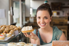Pretty brunette holding lemon meringue pie Stock Image
