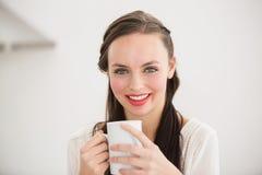 Pretty brunette holding a mug Stock Images