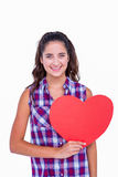 Pretty brunette holding paper heart Royalty Free Stock Photography