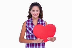 Pretty brunette holding paper heart Stock Images