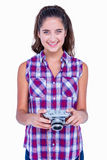 Pretty brunette holding photo camera Royalty Free Stock Images