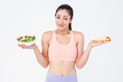 Pretty brunette holding pizza and salad Stock Image