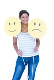 Pretty brunette holding smileys faces Royalty Free Stock Images