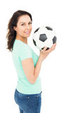 Pretty brunette holding soccer ball Royalty Free Stock Photos