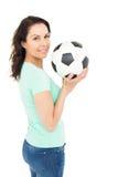 Pretty brunette holding soccer ball Royalty Free Stock Photos