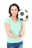 Pretty brunette holding soccer ball Royalty Free Stock Photography