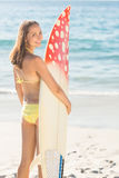 Pretty brunette holding surf board Stock Images