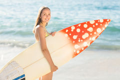 Pretty brunette holding surf board Stock Photo