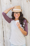 Pretty brunette holding take away coffee Royalty Free Stock Images