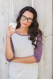 Pretty brunette holding take away coffee Royalty Free Stock Image